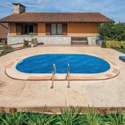Cubierta isotérmica para piscina enterrada Gre ovalada 300 micrones